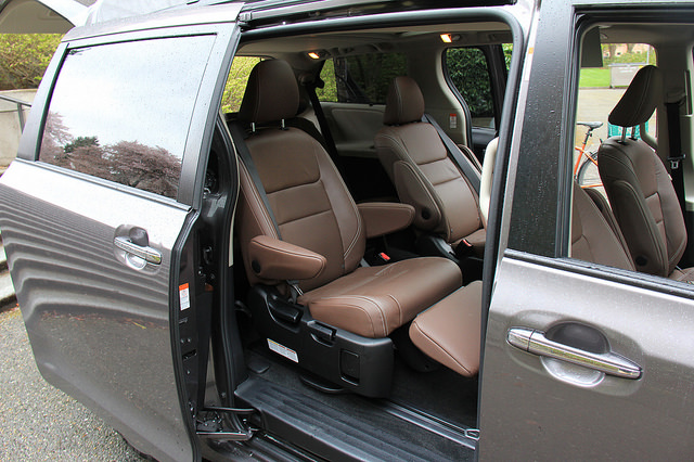 2015_toyota_sienna_second_row_fold_out_foot_rest_chestnut_leather